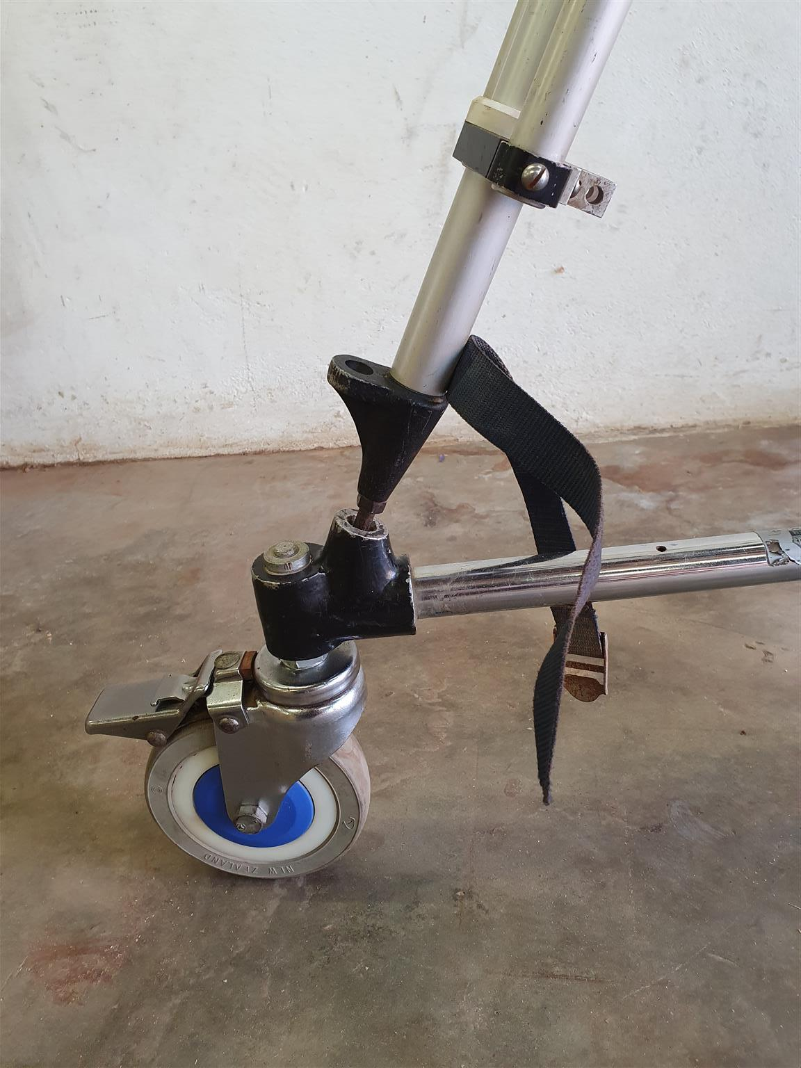 Top Quality Peter Lisand tripod with a Universal Fluid Head and a Miller Dolly in good condition