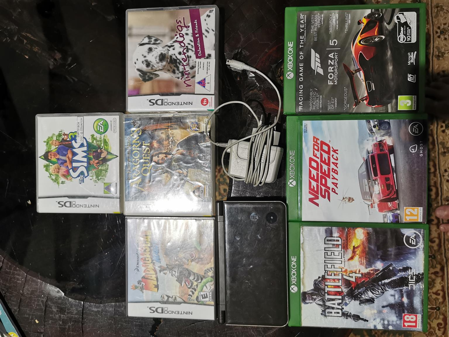 Nintendo DSI XL with 4 Nintendo games and 3 Xbox one games
