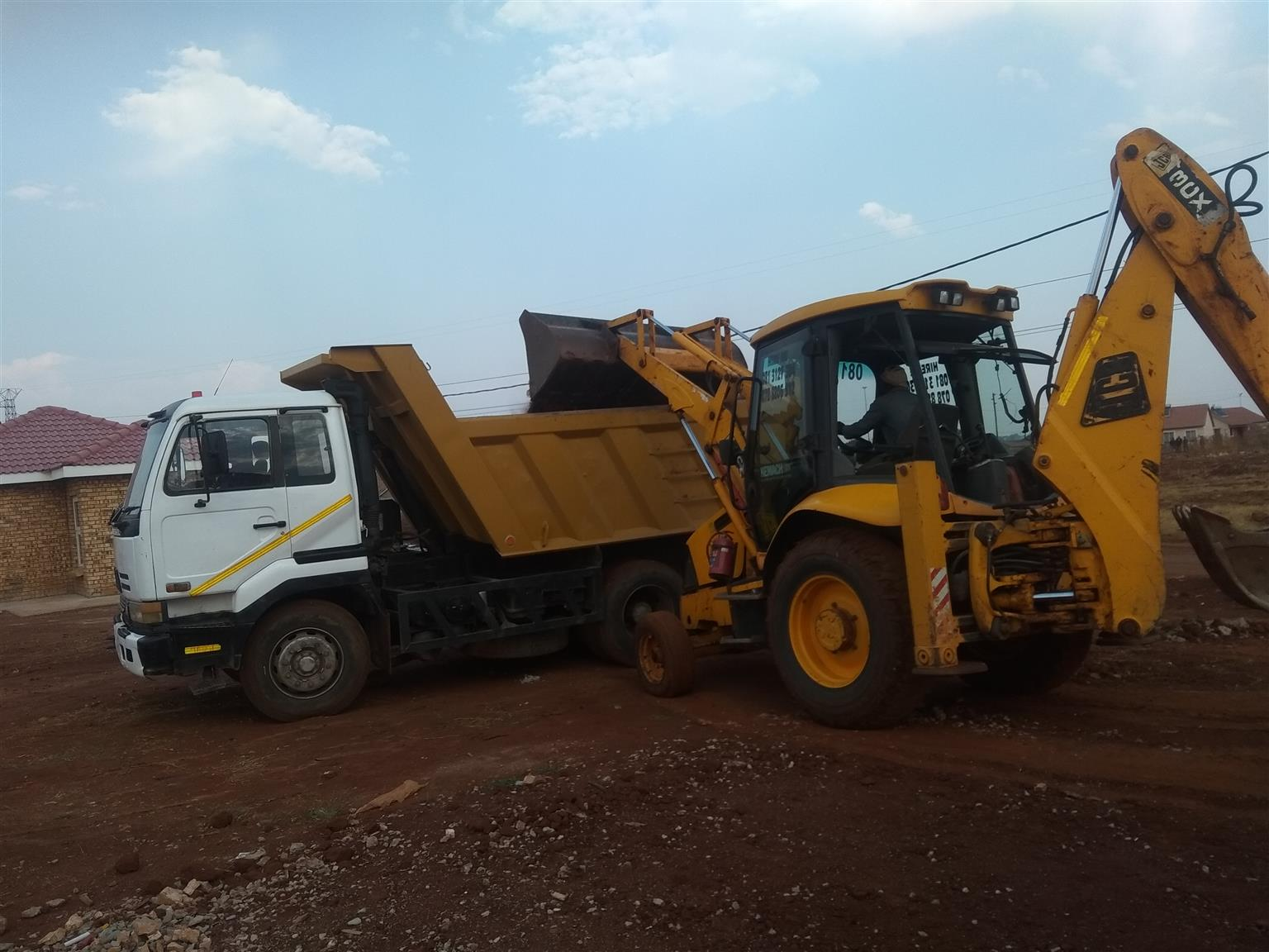 TLB and Tipper trucks