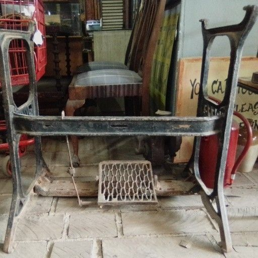 Vintage cast iron sewing machine stand
