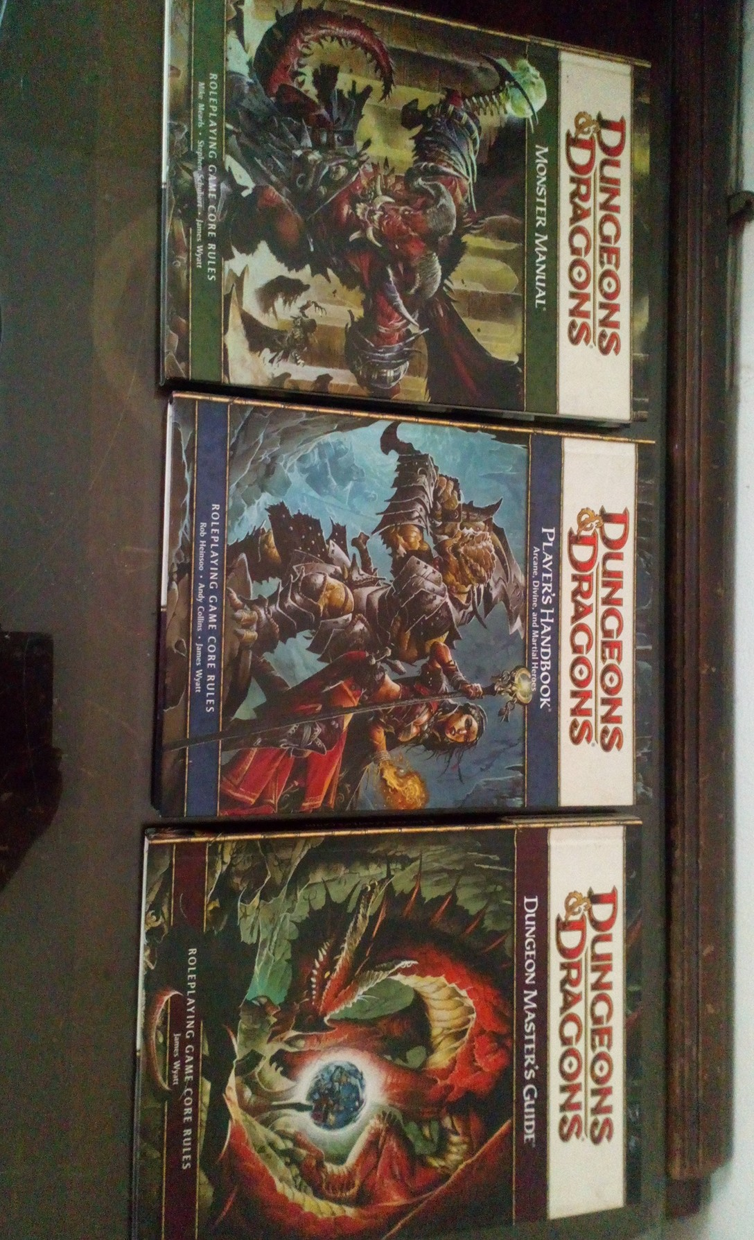 4th edition Dungeons and Dragons Players hand book, Monster manual and Dungeon masters guide.