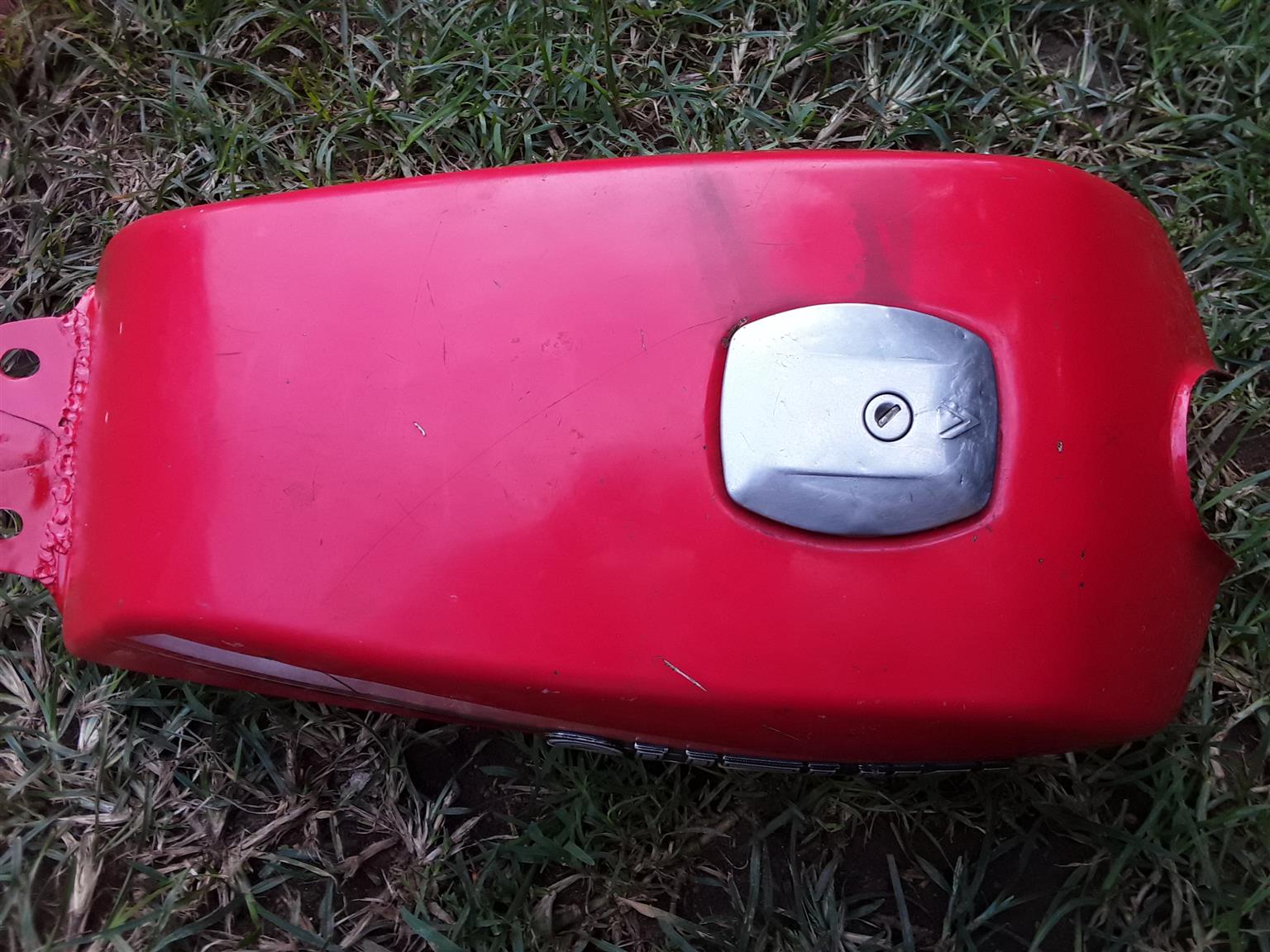 Petrol Tank for Suzuki Motor Bike. As good as new. With the fuel tap and filter. And the Fuel Cap.