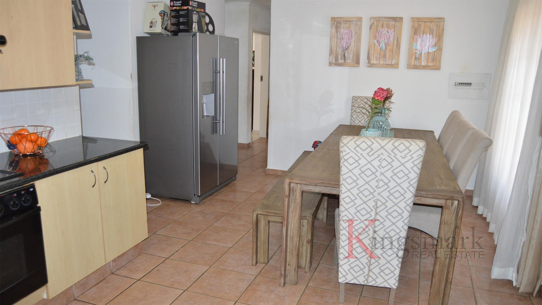 Three Bedroom Simplex with Private Garden and Double Garage