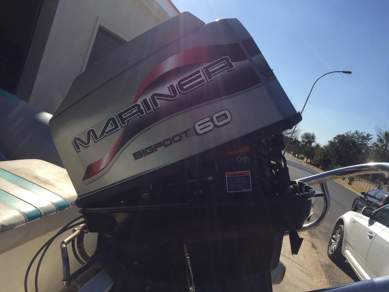 Presitige Duck with 60HP Mariner auto trim and Tilt