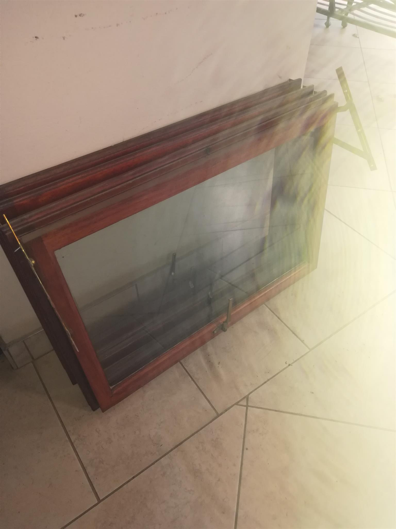 Safety window glass and wooden window frames. Price negotiable.