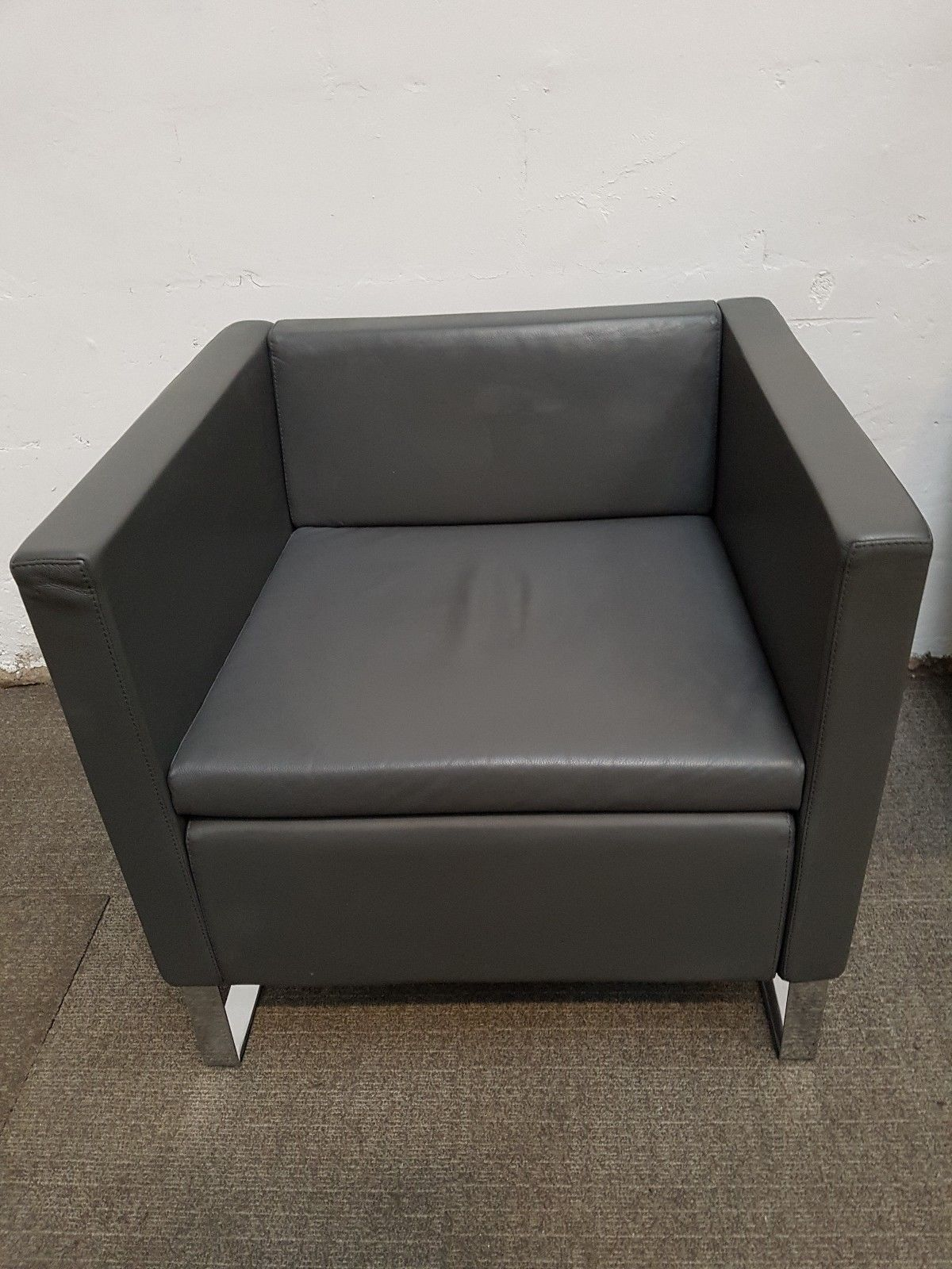 Grey leather office waiting room chairs r700 each