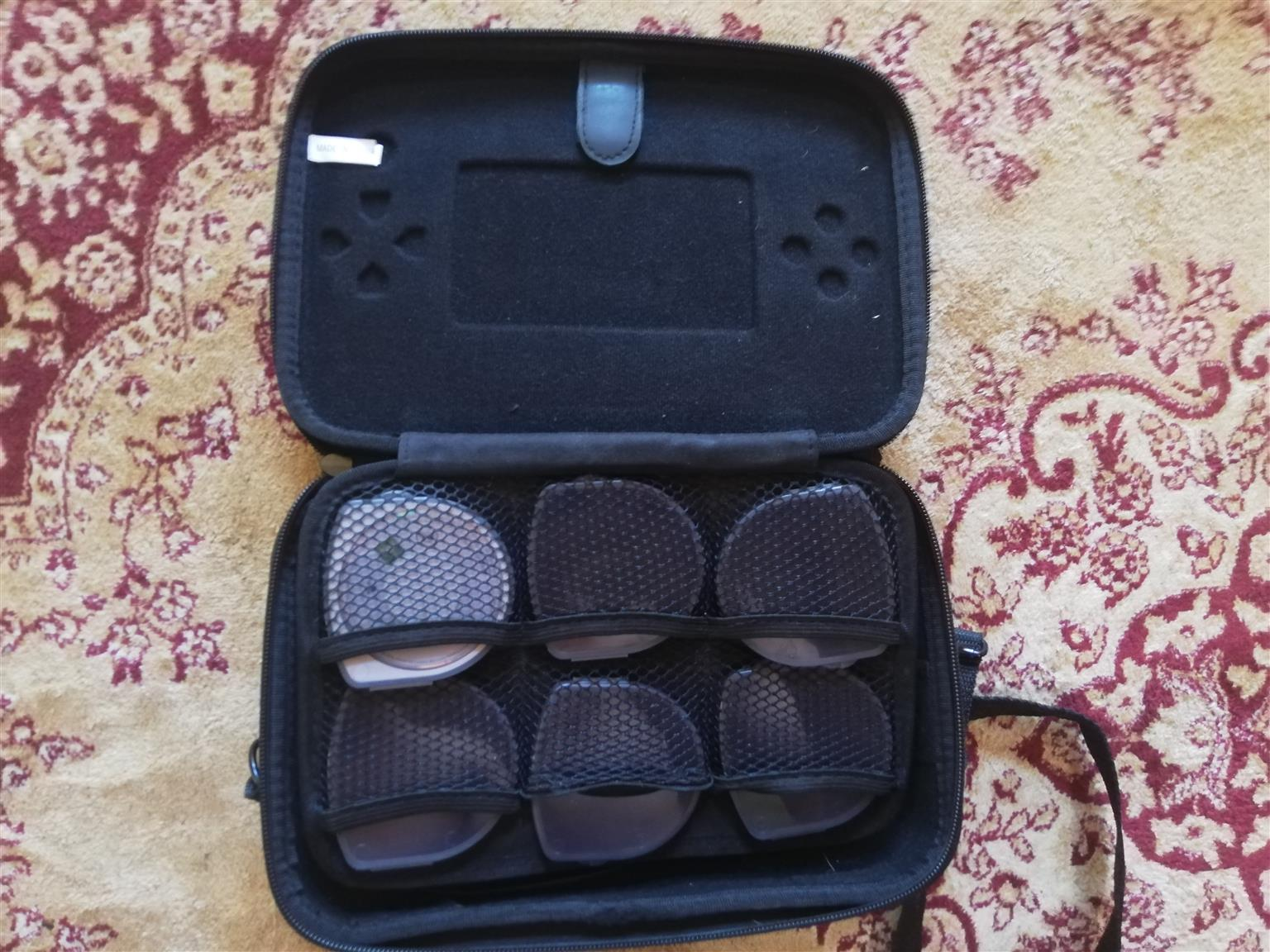 PSP console with PSP camera, carrying bag and Several Games