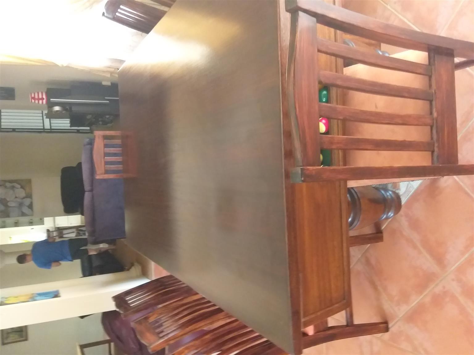 Sleeper wood bar and pool table.
