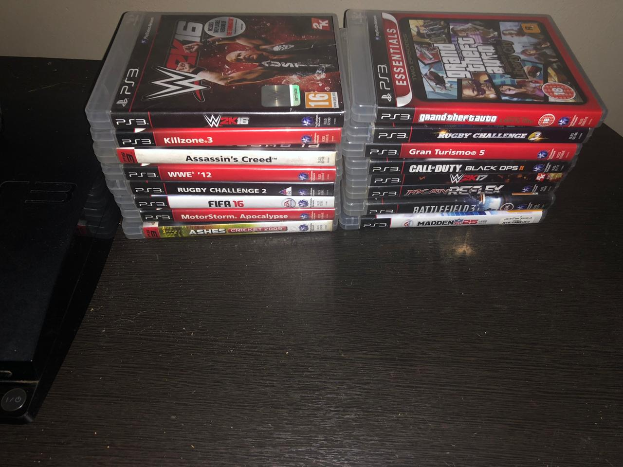 PS3 with all its gamesc+singstar and singstar mics