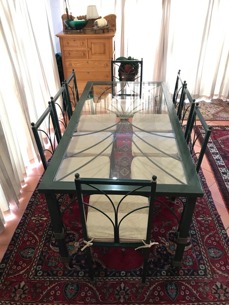 Glass top patio table with 8 chairs for sale