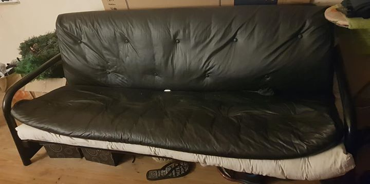Black leatherette sleeper couch. No tears or scratches. Steel frame. 2metres long. Exclude white mattress underneath