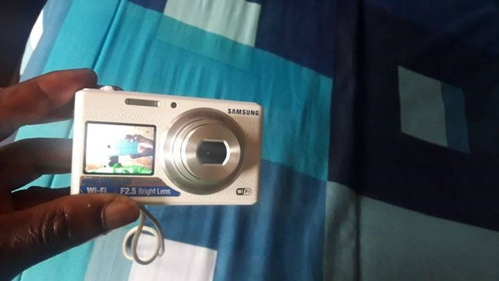 Samsung smart camera it has wi-fi, it has front camera, 16.2 megapixels it take small sd card and it takes a normal Samsung charger