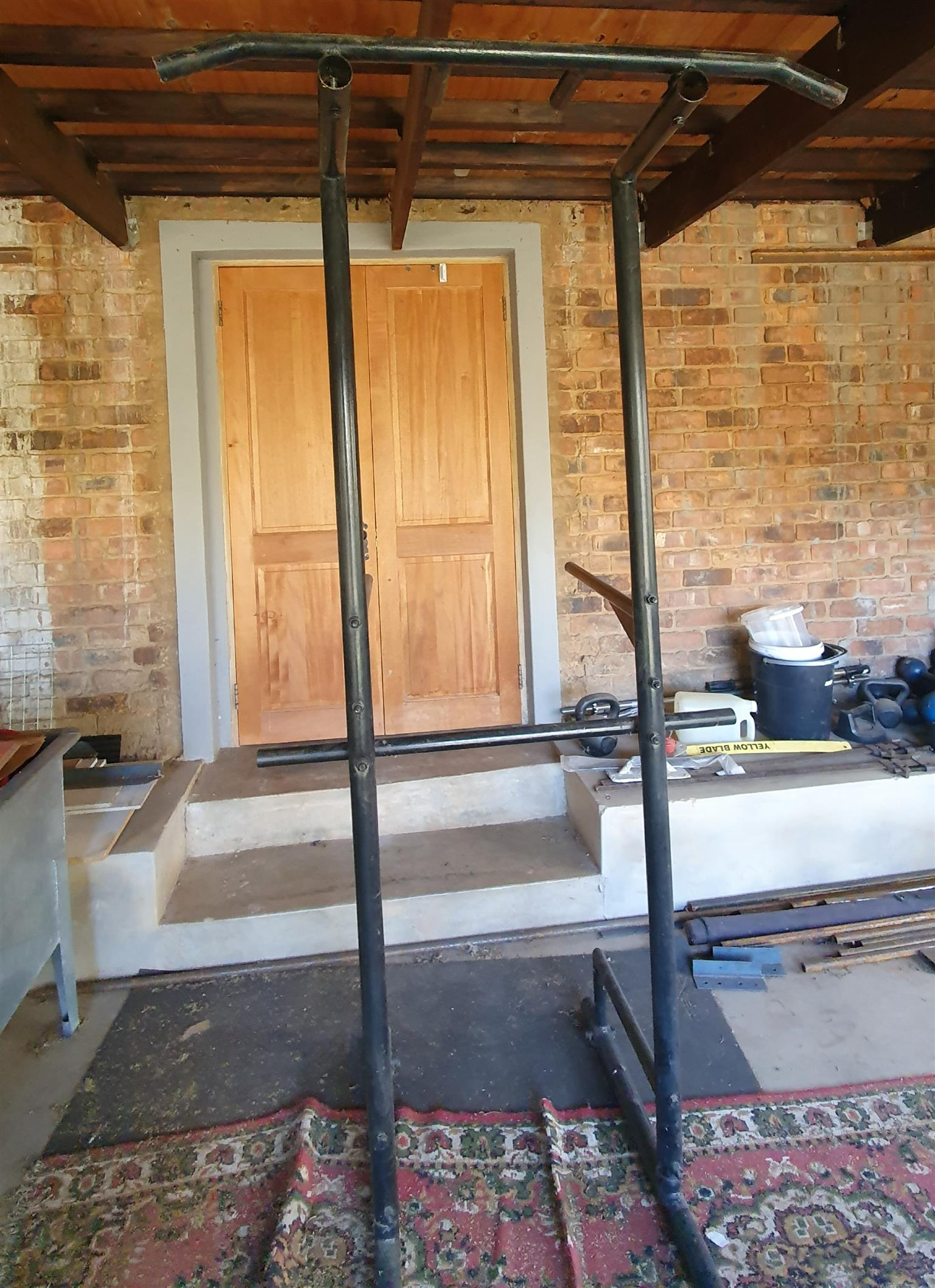 Combination pull-up and dip bar