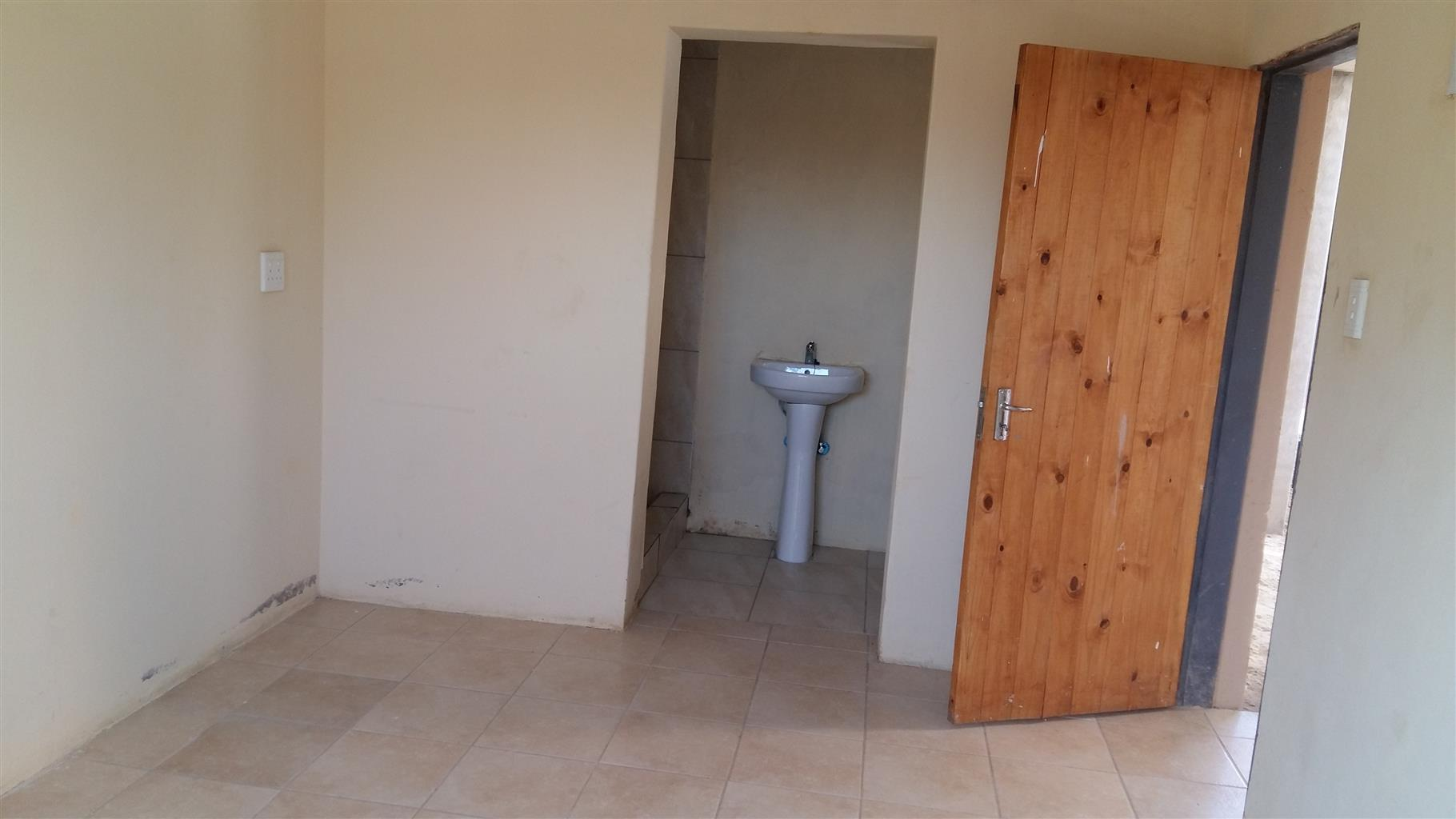 Bachelor room with shower toilet basin and kitchen sink available now at protea glen