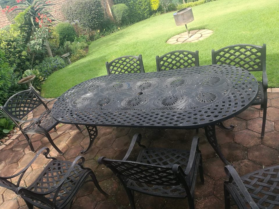 8 seater cast iron table and chairs