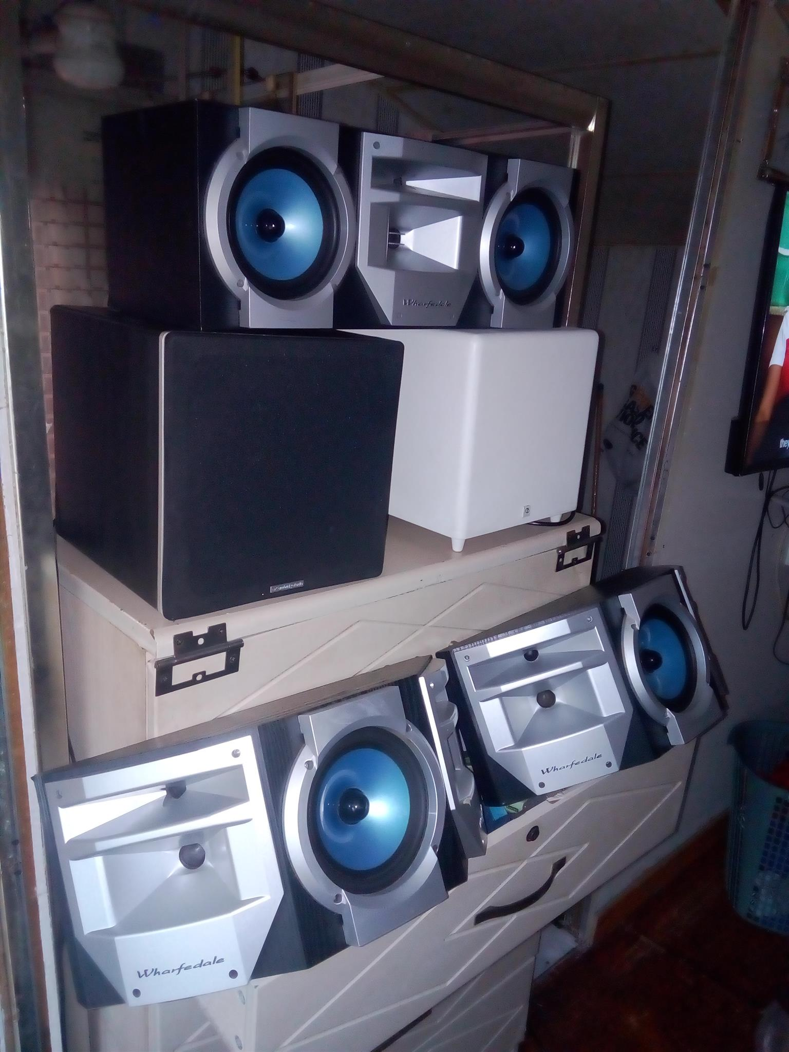 Boston subwoofer and Cambridge subwoofer with 3 whardale huge centre and surround speakers.