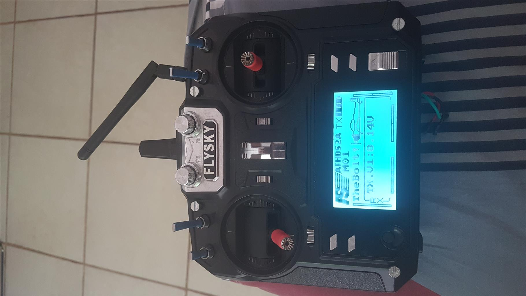 FPV setup with remote, batteries, charger and parts.