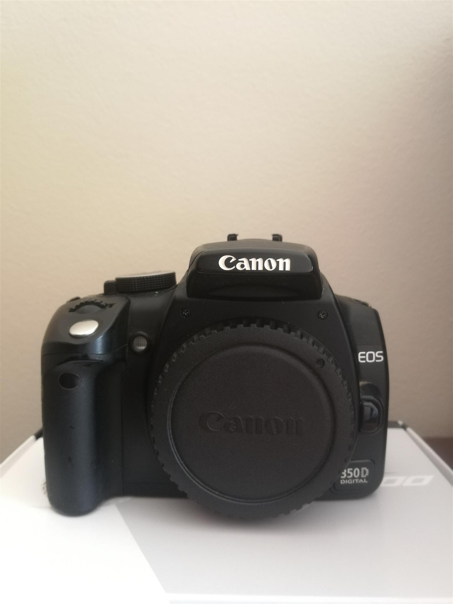 Canon 350D body+battery+charger. Manual included