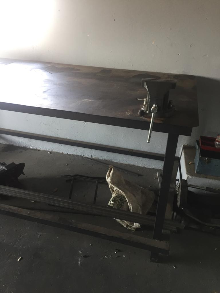 Steel workshop table with vice and various steel cupboards