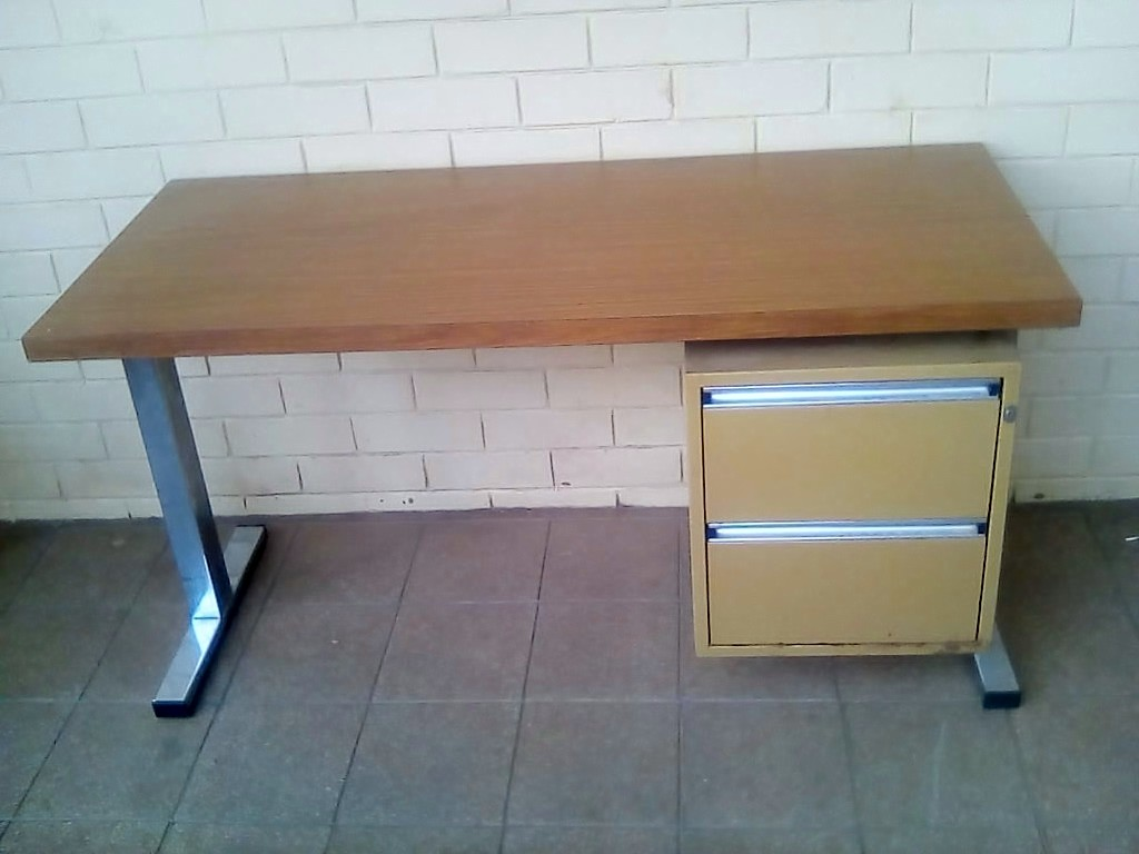 4 Foot wood and steel table. Table size. 125cm X 55cm and 66cm high.