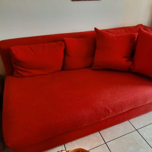 Red couches x 2