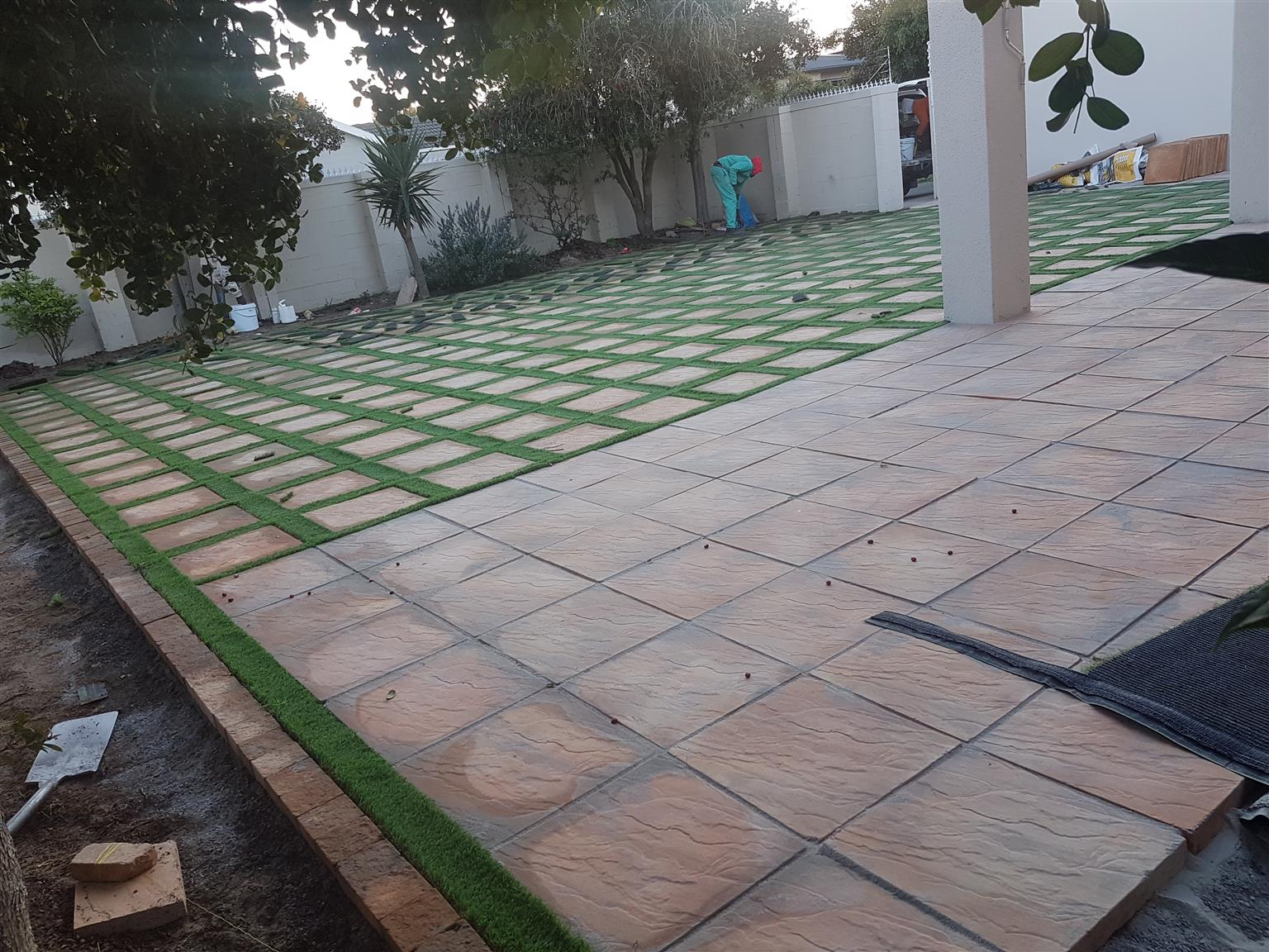 Artificial grass installation,paving, Natural grass and landscaping