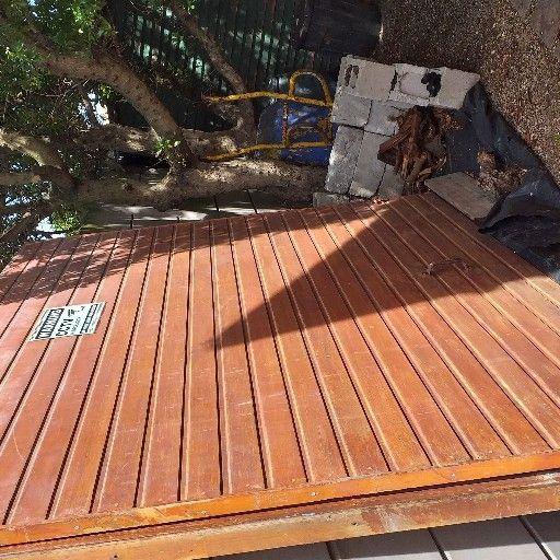 2 meranti garage doors very good condition 1 new hinges