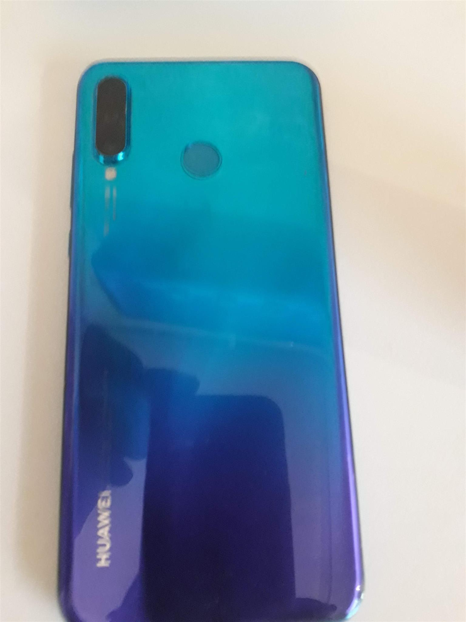 2019 Huawei P30 lite 13 months old. As good as new with no scratches or cracks. Peacock blue, dual