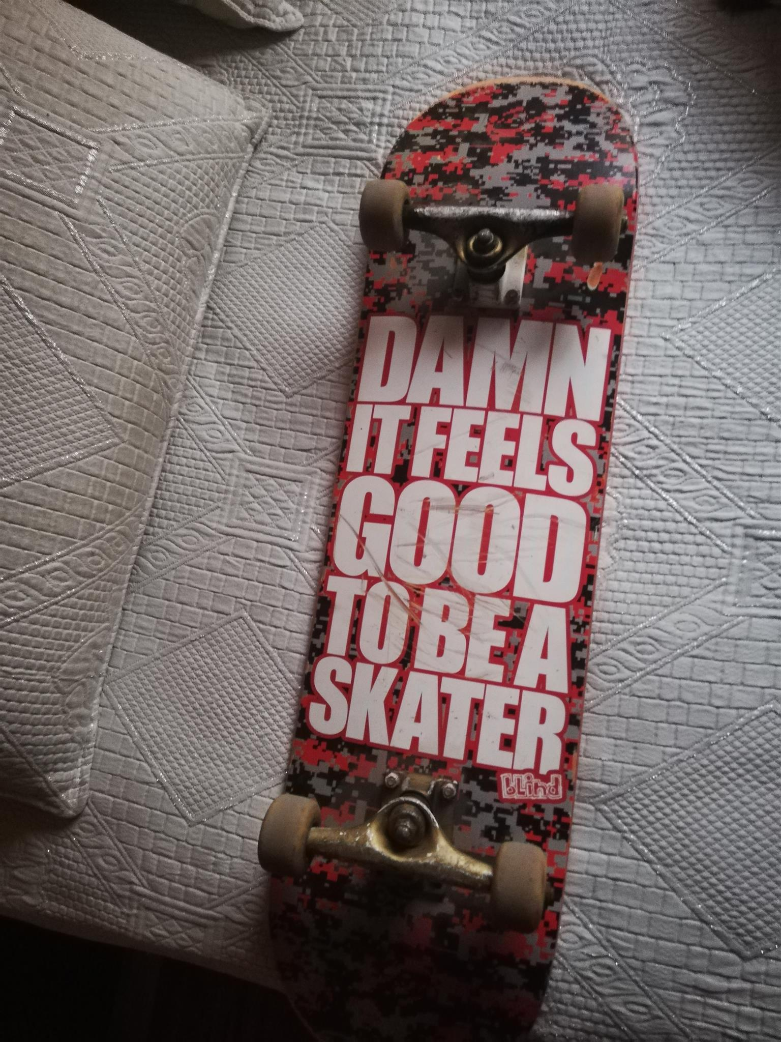 Skateboard with new grip and no cracks on the deck, used wheel with abec 7 bearings with all bolts and nuts