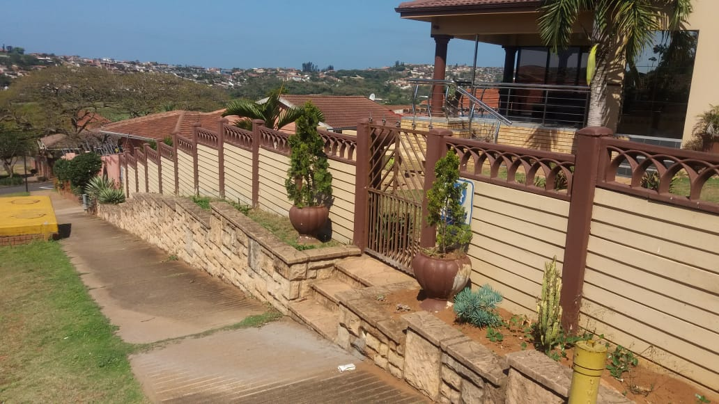 Concrete fencing, driveway, pedestrian gate and gate motor