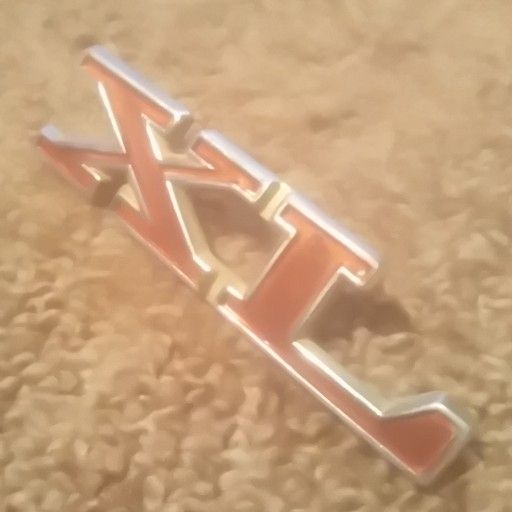 XL badge, older Ford