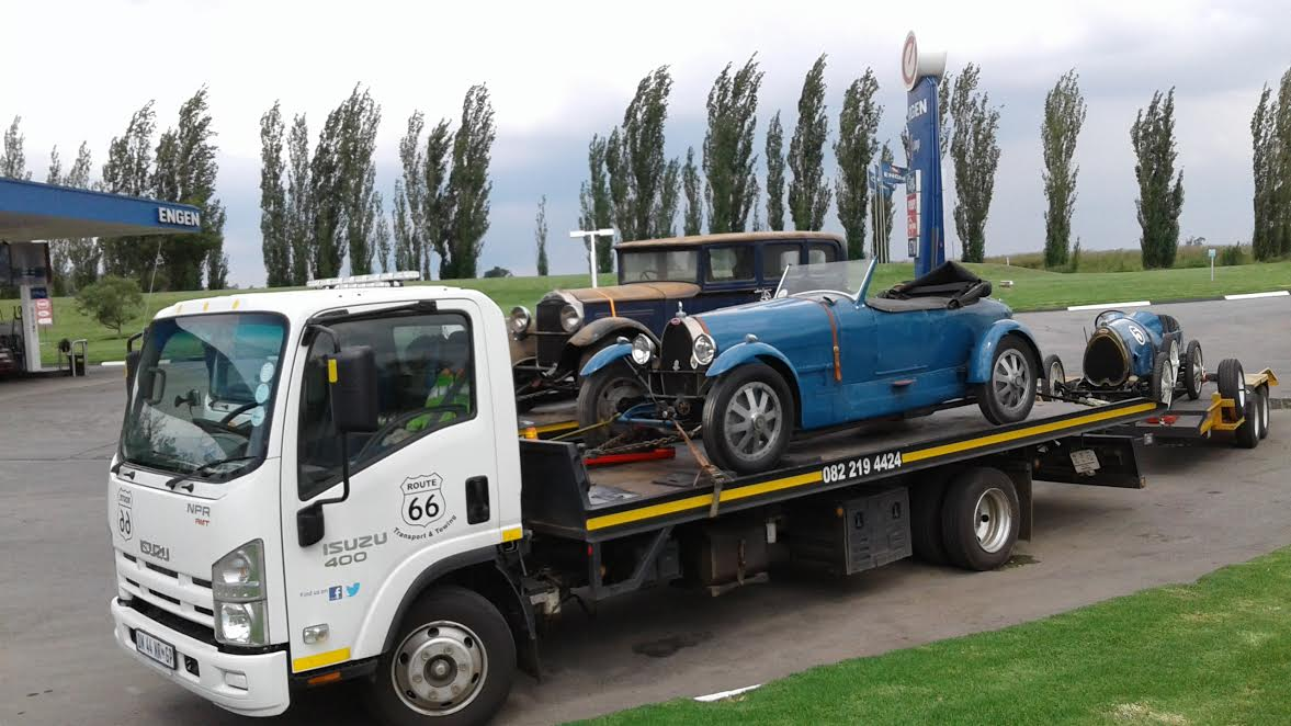 VW and other Classic Car Transport with flatbed rollback truck.