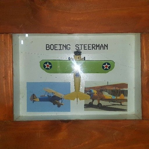Boeing Steadman model airplane in display case