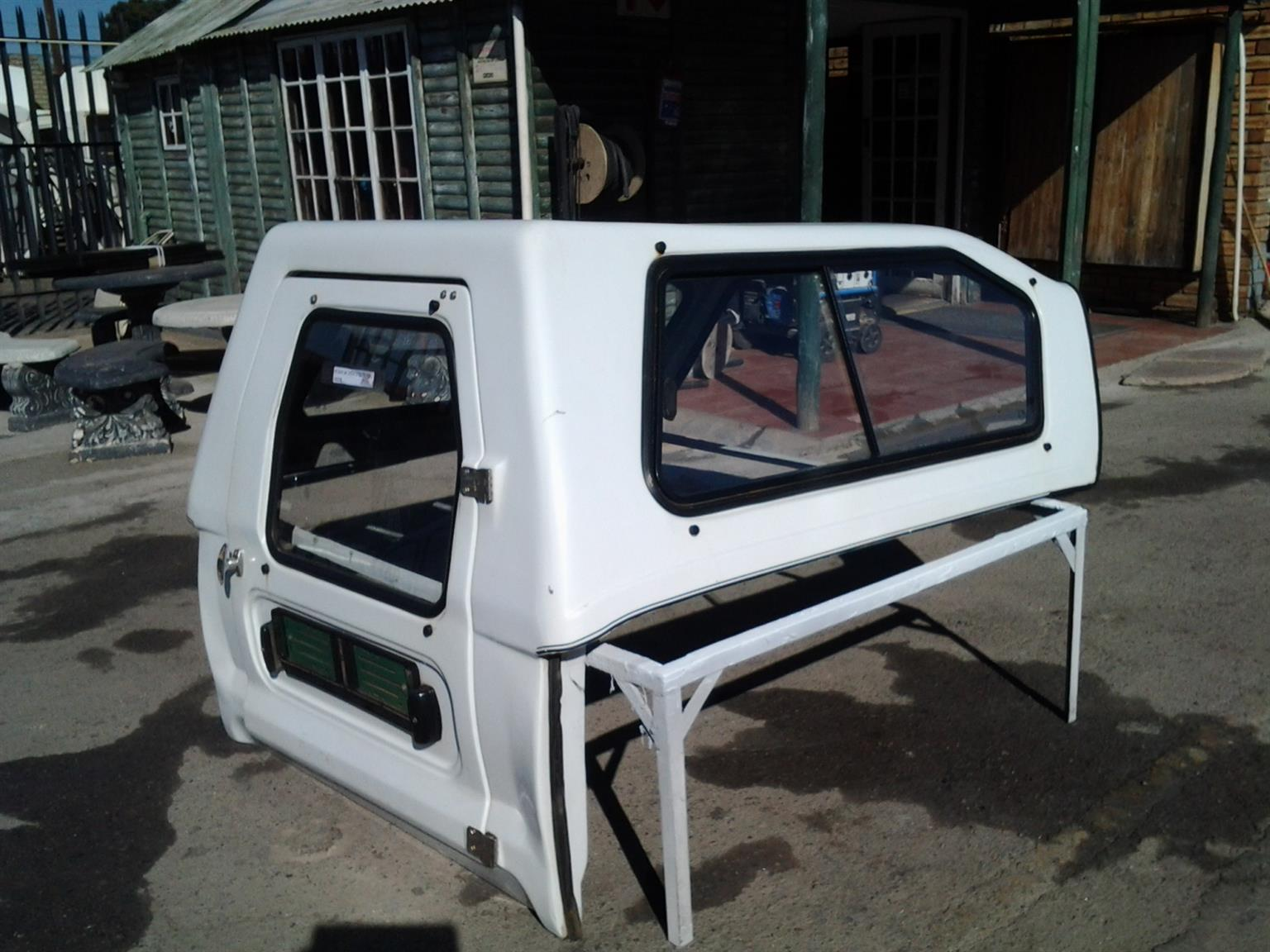 PRE OWNED SA CHEV UTILITY FULL DOOR CANOPY FOR SALE!!!!