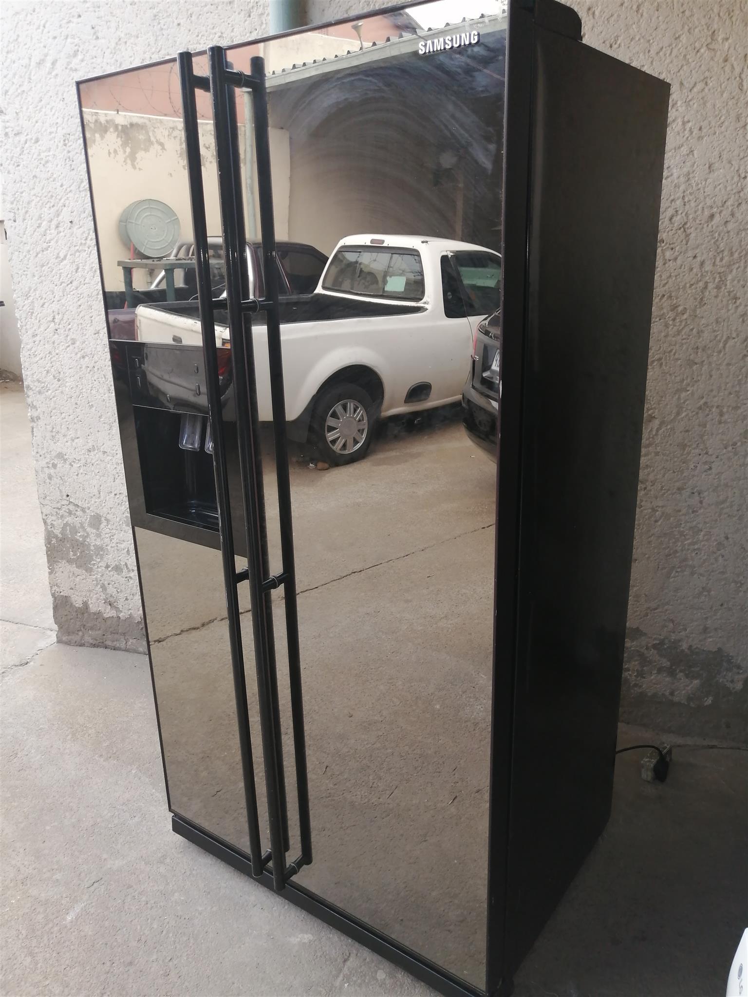 Fairly used double mirror door Samsung fridge