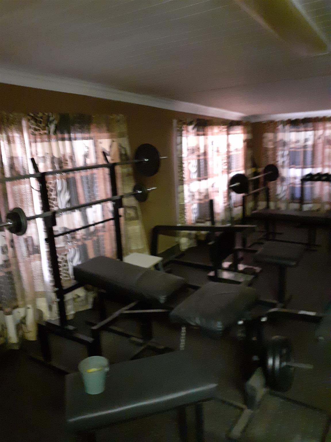 Full Home Gym with variety of equipment and weights