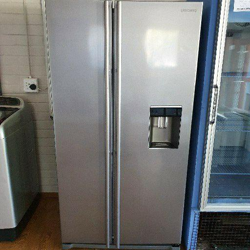 Samsung metallic silver side by side with water dispenser