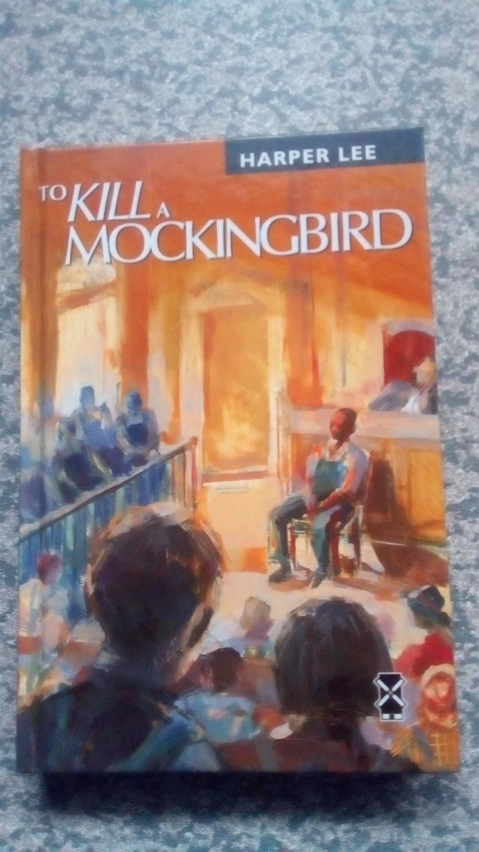 To kill a mocking bird by Harper Lee (hard cover)