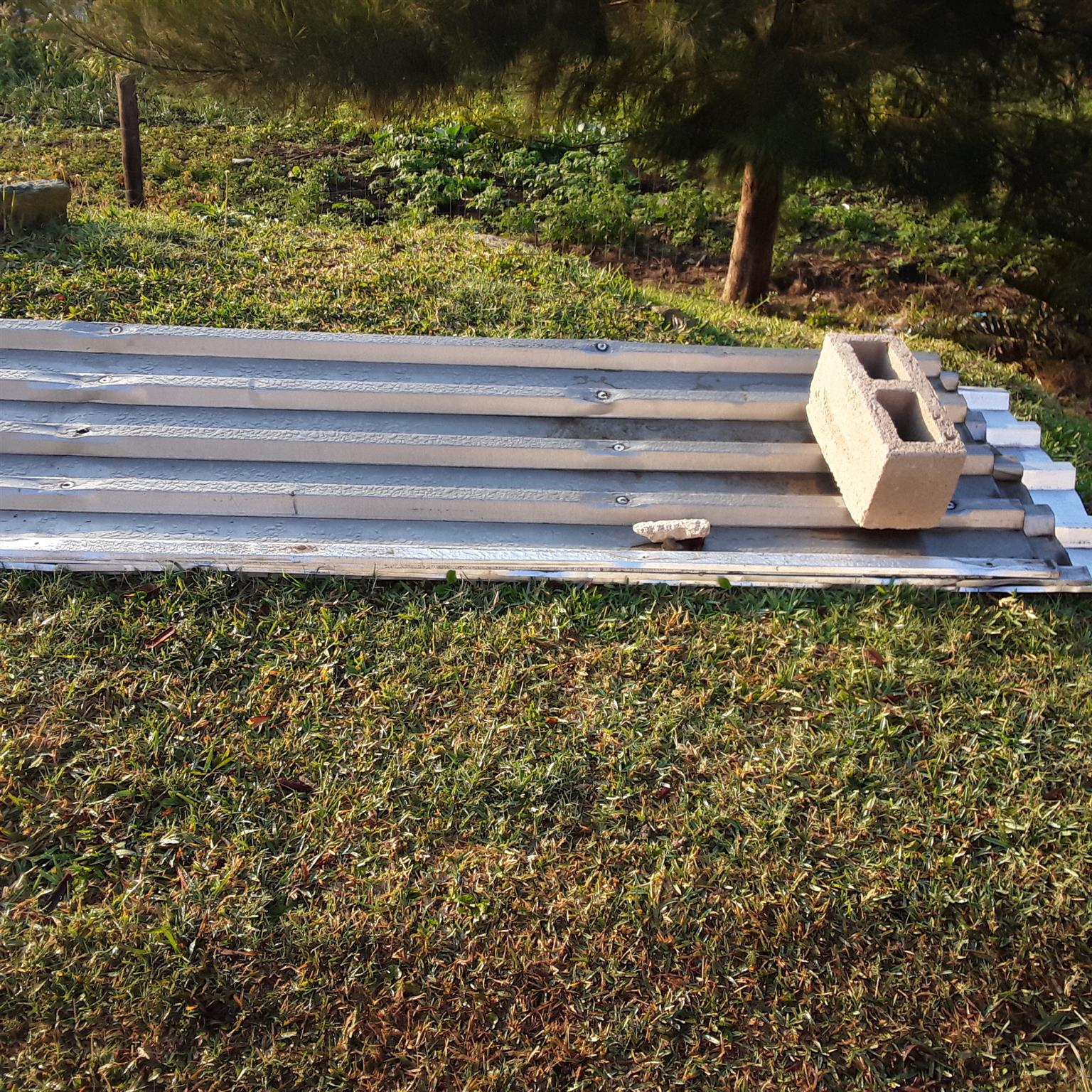 roll up door, new fencing pole,used  IBR roof sheet