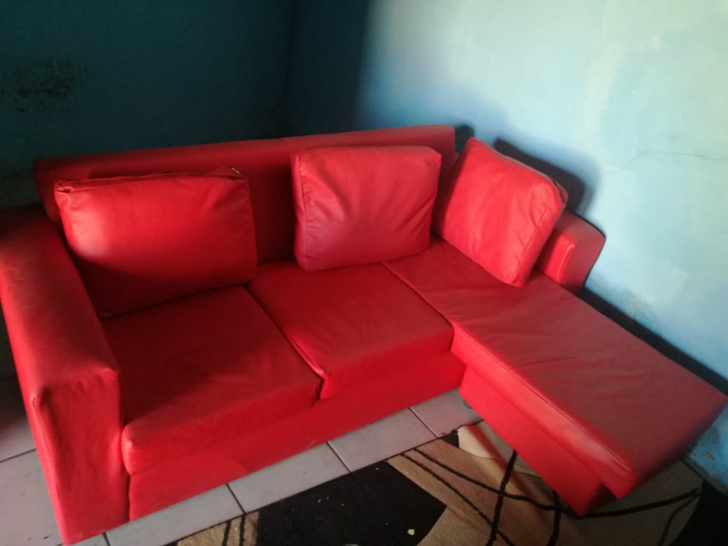Red Corner Couch Junk Mail