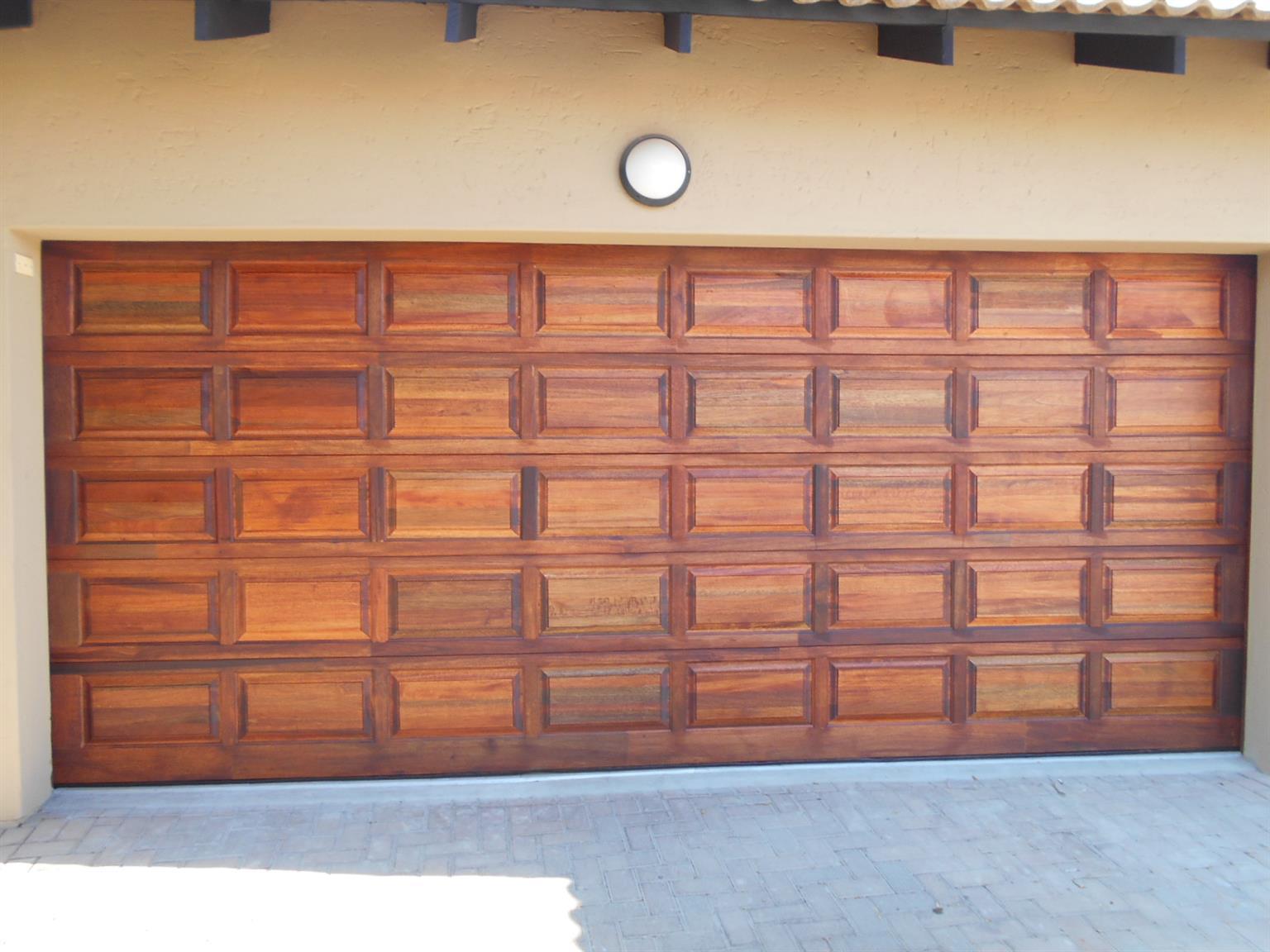 Single and double meranti garage doors in Fourways