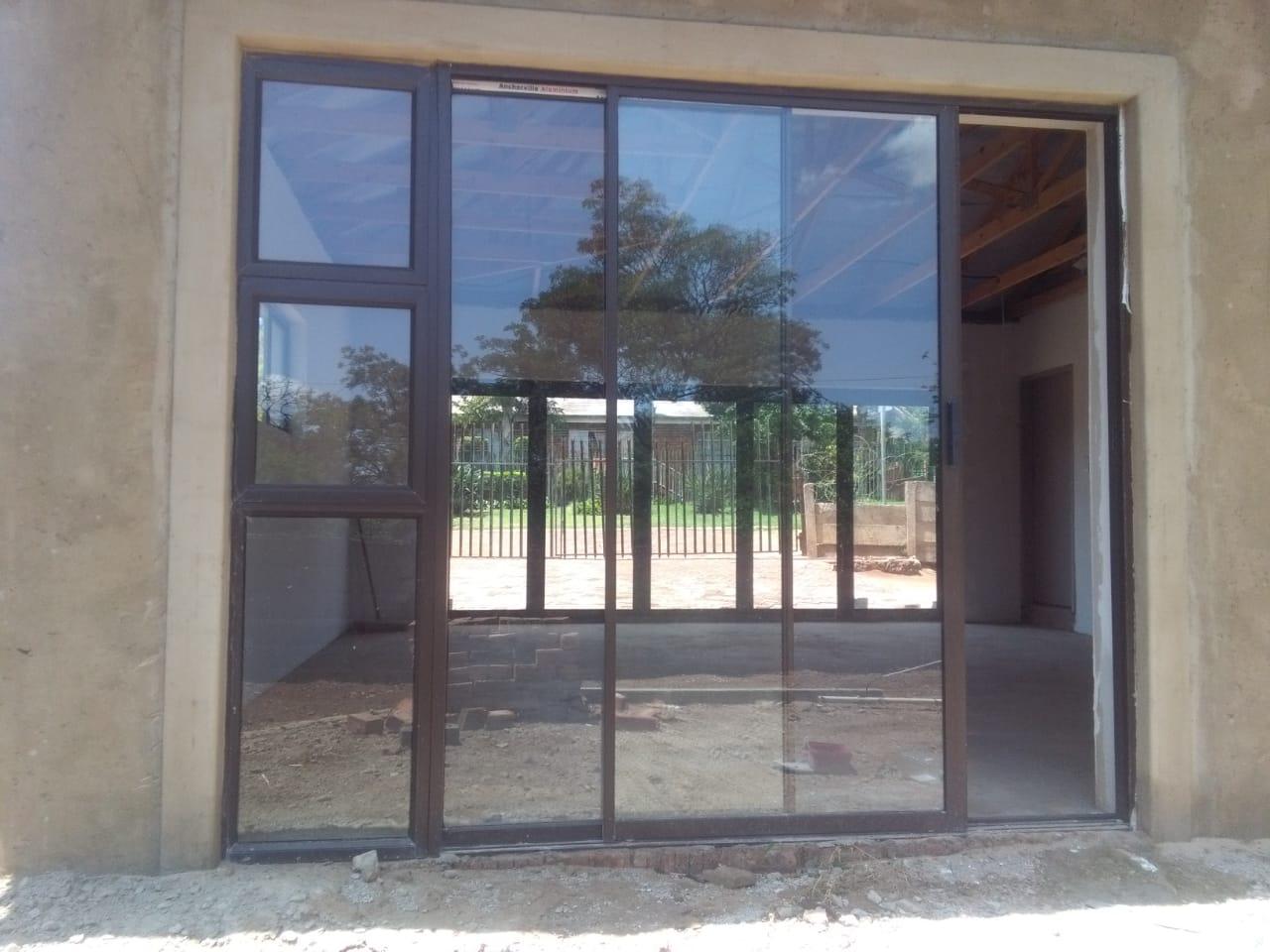 ERIC ALUMINIUM WINDOWS DOORS FOLDING DOORS SLIDING DOORS BALUSTRADES & STEELWORKS
