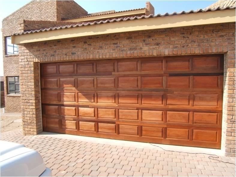 Garage Doors meranti with electronics sliding stuff. wooden meranti automated
