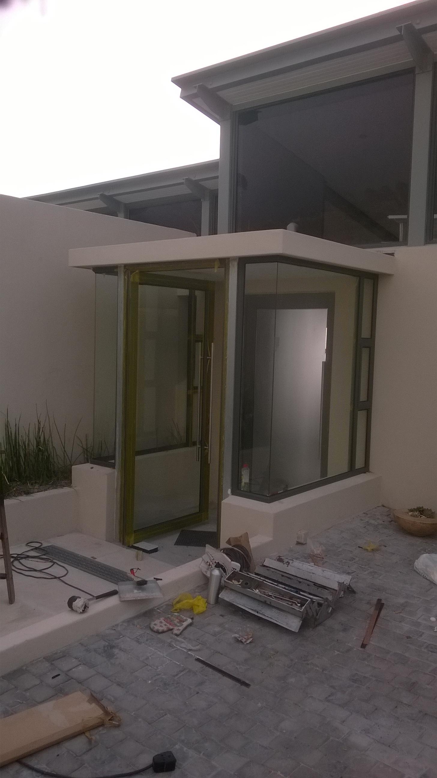 Aluminium doors and windows, specialing in rolling of aluminium sections.