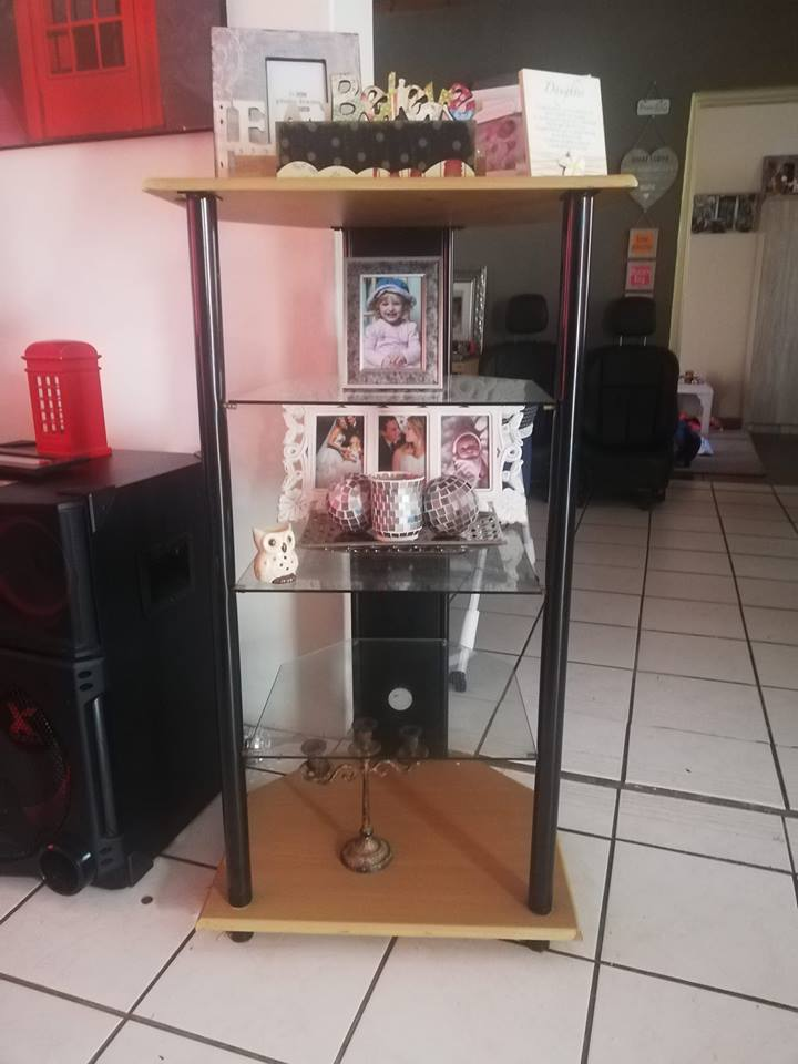 Two free standing glass shelve stands