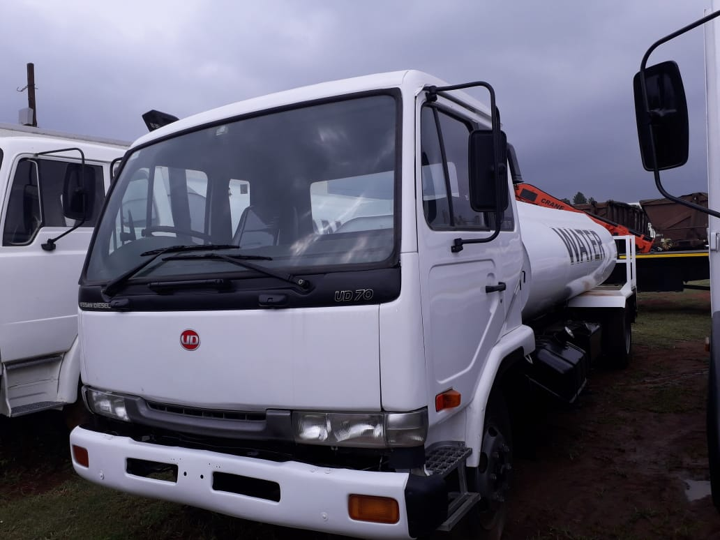 UD AND WATER TANKER TRUCK