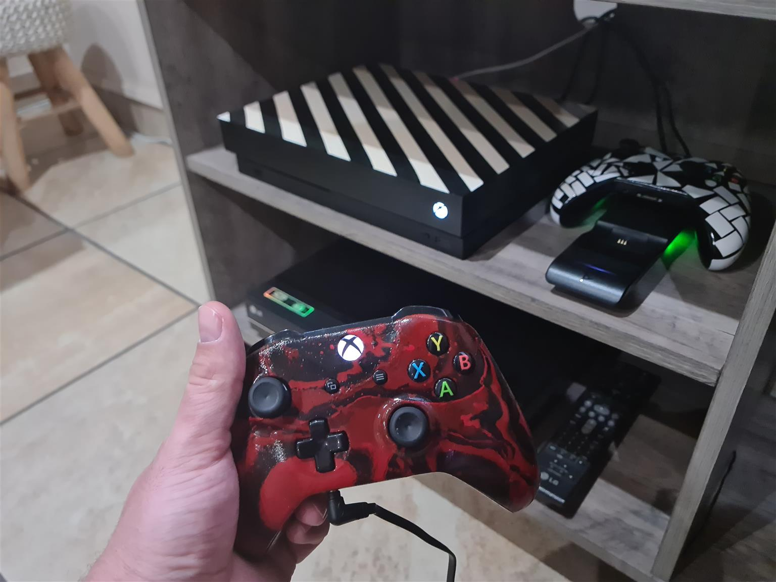 Xbox One X Immaculate Condition with remotes wireless charger and 2 remotes..