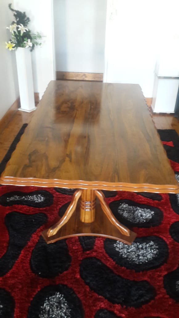 4-6 seater Dining table, very solid yet very light in weight with removable top.