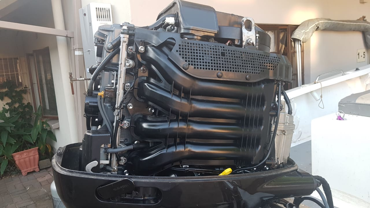 Suzuki 150hp 4 stroke outboard for sale with controls and gauges | Junk Mail