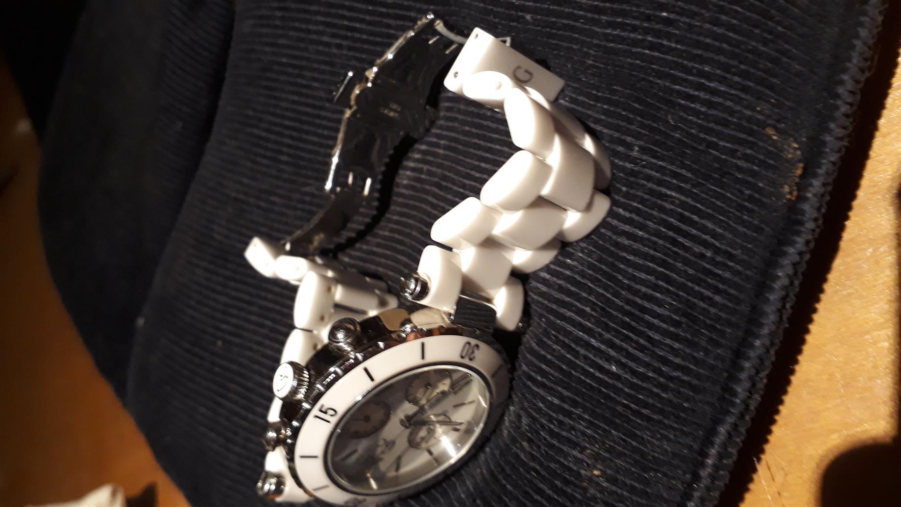 Ladies Guess watch.  White non-scratch ceramic strap.  Excellent condition.